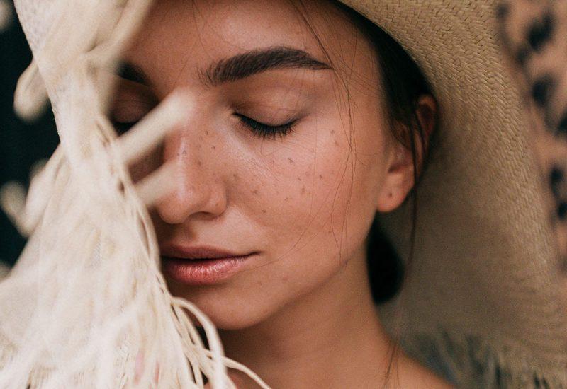 photo-of-woman-wearing-straw-hat-3597101